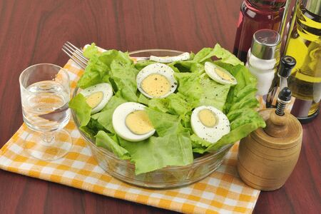 Mimosa salad with lettuce and boiled eggs