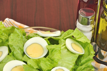 Mimosa salad with lettuce and boiled eggs -  close up