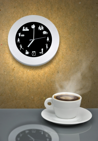 coffe break: It is coffe break time - metaphor with clock and cup of coffe Stock Photo