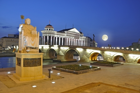 Skopje night scene at dawn - Macedonian museum of Archeology with full moon