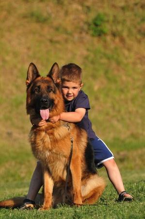 a boy and a German Shepherd