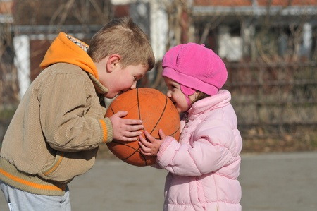 boy and girl with the ball Stock Photo