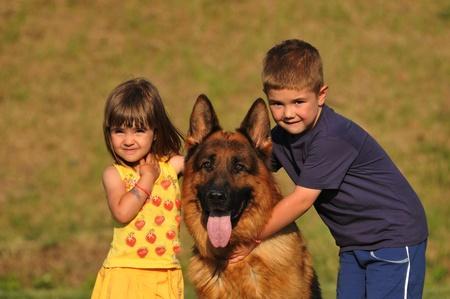 german shepherd: boy and girl with dog