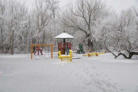 playground covered with snow photo