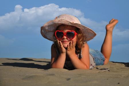 beautiful girl lying on the sand photo