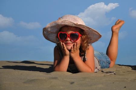 beautiful girl lying on the sand Stock Photo
