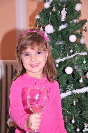 Happy Christmas - Little girl and Christmas tree Stock Photo - 18494153