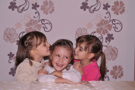 Children whispering photo