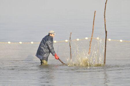 botas altas: pescadores
