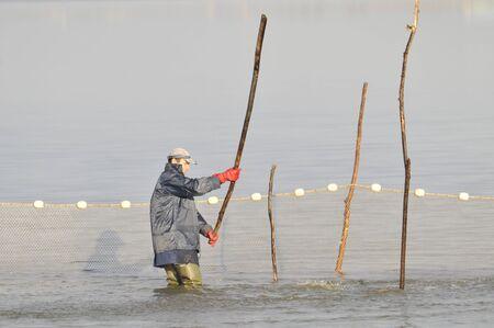 botas altas: pescador