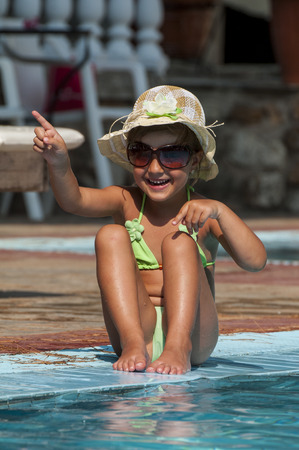 Happy Little Girl in Swimming Pool photo