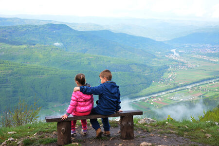 nfld: Family on a mountain lookout observing nature Stock Photo