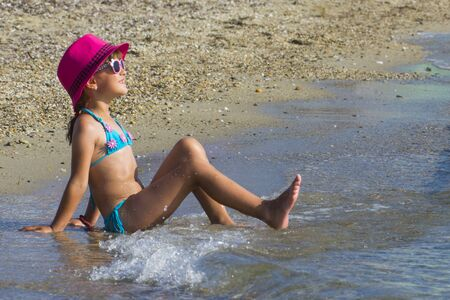 Little girl  on beach during summer vacation