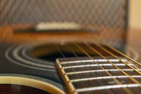 Classic vintage acoustic guitar with visible frats and wires. Close-up view