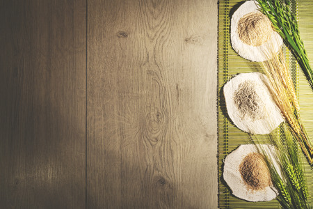 Rustic cooking background with different flours on the right side. Top view