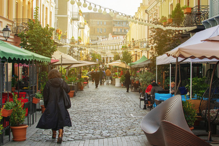 TBILISI, GEORGIA - NOV 01 2018: People walking on reconstructed street David Agmashenebeli with lot of new restaurants and cafes