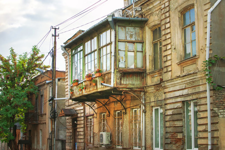 Classic Georgian style Old wooden balcony on the street of Tbilisi old town 免版税图像