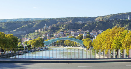 View at Bridge of Peace, Narikala fortress and Tbilisi old town, Georgia. Beautiful sunny autumn day.
