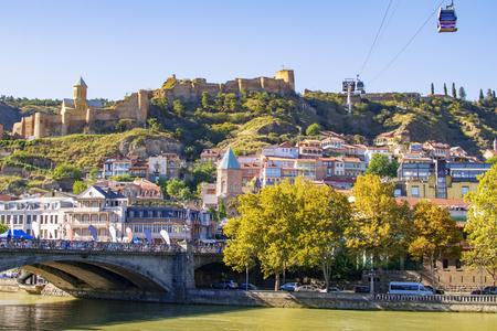 View at Metehi bridge, Narikala fortress and Tbilisi old town. Georgia, famous tourist places.