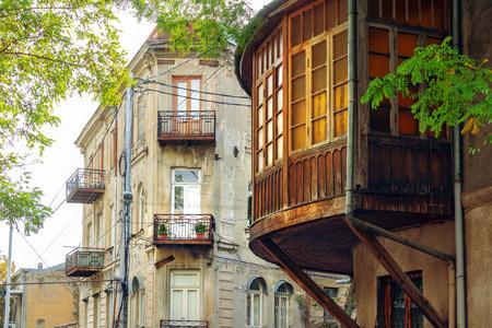 Big beautiful rounded wooden Georgian style balcony on the street of Tbilisi, Georgia