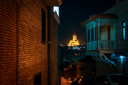 Georgia, Tbilisi - 05.02.2019. - Night scene from the streets of Tbilisi old town. Beautiful holy trinity Sameba church in the background - Night image