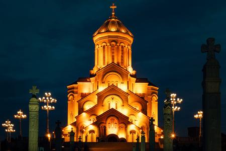 Georgia, Tbilisi - 05.02.2019. - Famous Orthodox Holy Trinitiy Sameba church illuminated with golden light. Night time photography