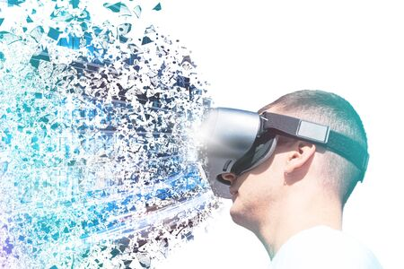Young male wearing VR (virtual reality) glasses. Futuristic innovative technology concept projecting virtual image in the air