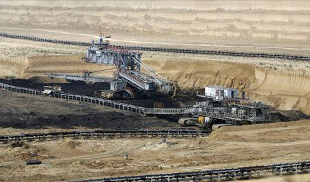 kostolac: KOSTOLAC, SERBIA - October 01, 2009  Bucket wheel excavator in surface coal mine Kostolac in central Serbia  Excavated lignite is used to supply nearby power plant with which produces 14  of entire Serbian electrical power  photo  Pedja Milosavljevic