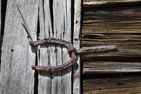 antique horseshoe used as barn door hinge Stock Photo - 90864915 - Antique Horseshoe Used As Barn Door Hinge Stock Photo, Picture And