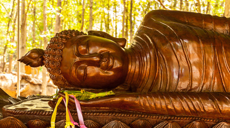 teakwood: Buddhist carve on teakwood in the Garden at ancient temple ,Thailand. Stock Photo