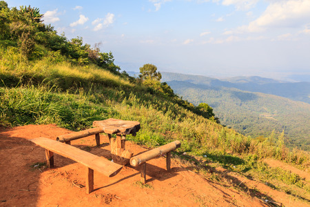 idyll: Lonely bench on a hill with mountain scenery around