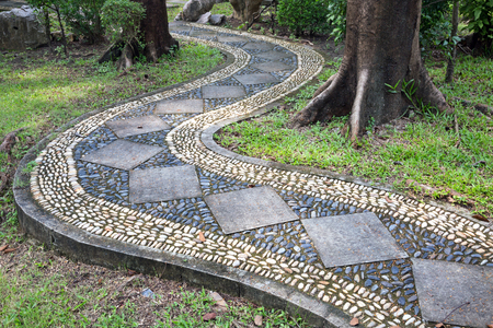 Stone walkway for relaxing in the park. Stock Photo