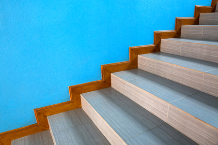 Beautiful staircase in the house with blue walls.