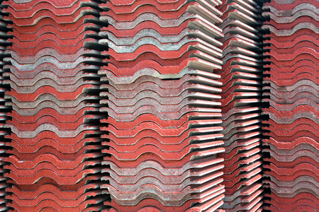 Colorful piles of roofing tiles for construction.