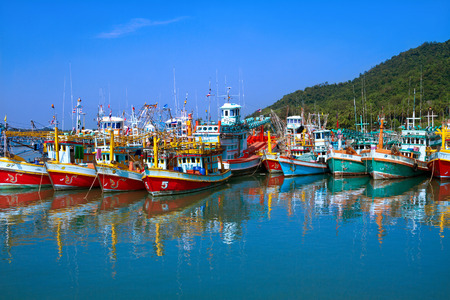 Colorful fishing boats are parked in the tropical sea  in Thailand.