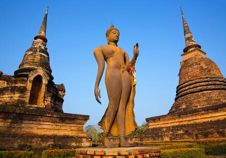 Ancient buddha statue in Sukhothai Historical Park , Sukhothai , Thailand.