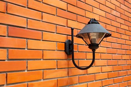Modern lamp on a brick wall 스톡 콘텐츠
