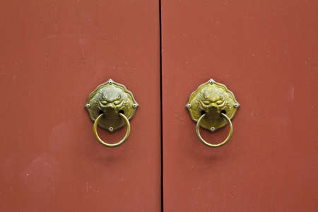 lionhead: lionhead knocker of a classic door in thailand Stock Photo