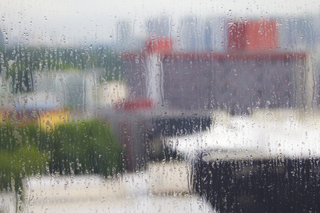buiding: natural water drops on window glass with buiding background