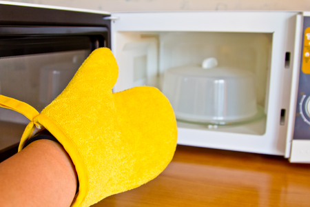 Protective orange gloves for a hot bowl of microwave
