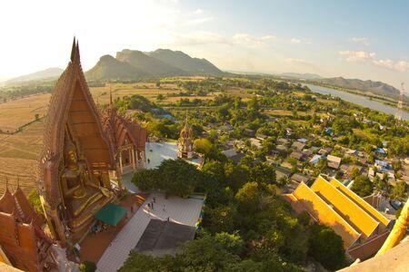 sue: The golden Buddha Image, Wat Tum Sue, Thailand Stock Photo