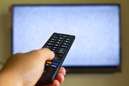 Television remote control changes channels thumb Stock Photo
