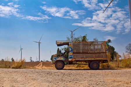 farmer truck with wind turbine background