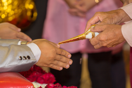 Watering the conch,Thai traddition wedding ceremony 스톡 콘텐츠