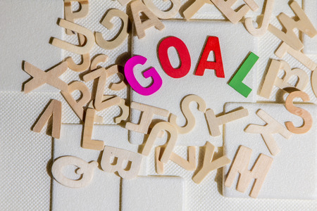 GOAL concept, colourful wooden text word goal