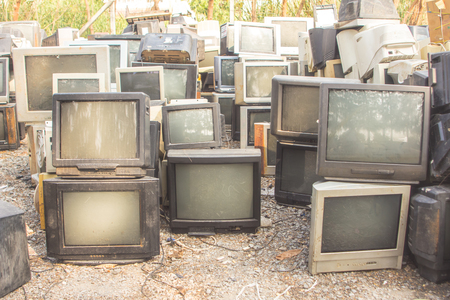 many televison destroy form flood in recycle area Foto de archivo