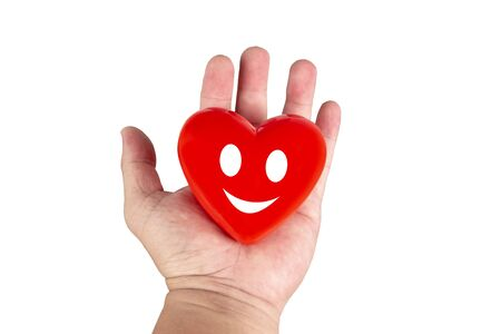 Red smilling heart on hand .isolated white background.