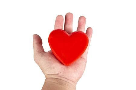 Red heart on hand .isolated white background. Stok Fotoğraf