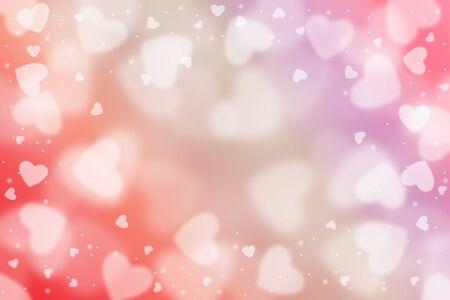 Saint Valentin, coeurs flous abstraits de particules légères et étincelantes.