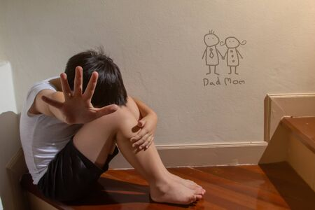 A boy hand of signal to stop,A fearful child, violence and aggression concept.